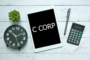 Business Owner Ordering C-Corp (Corporation) Formation online with tablet