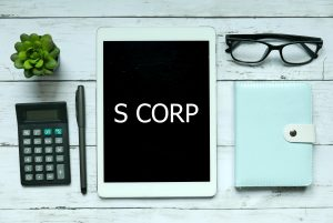 Business Owner Ordering S-Corp Formation online with tablet